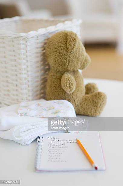 Notebook beside baby items