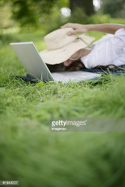 A notebook computer and a woman