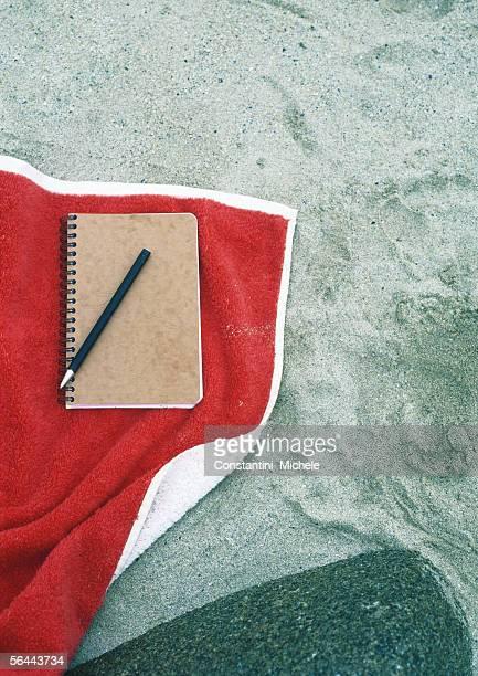 Notebook on beach towel