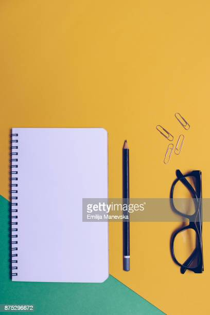 Notebook on yellow-green background
