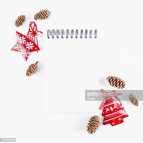 Notebook  with Christmas decoration on white background. Flat lay, top view