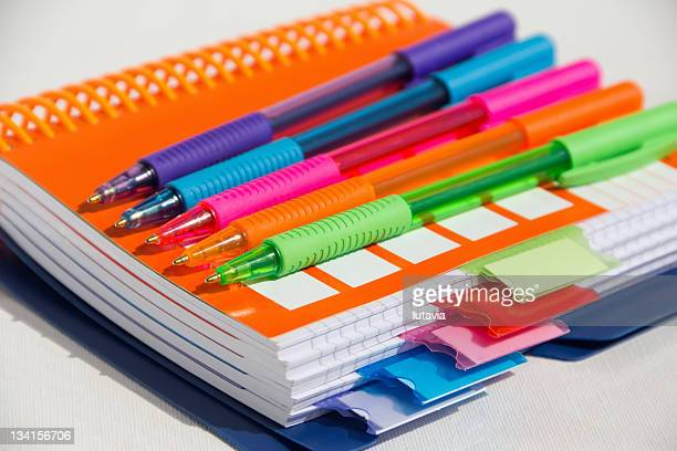notebook with colored pens - lutavia stock pictures, royalty-free photos & images