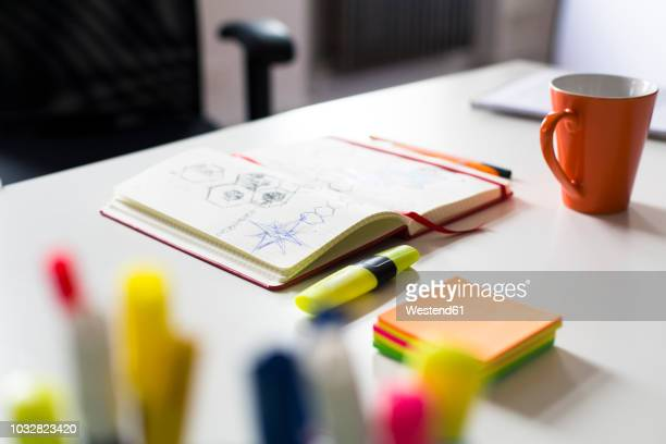 notebook with sketch, highlighters and cup of coffee on desk in office - highlights stock pictures, royalty-free photos & images