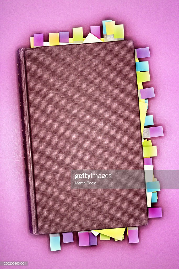 Notebook with sticky notes marking pages, overhead view : Stock Photo