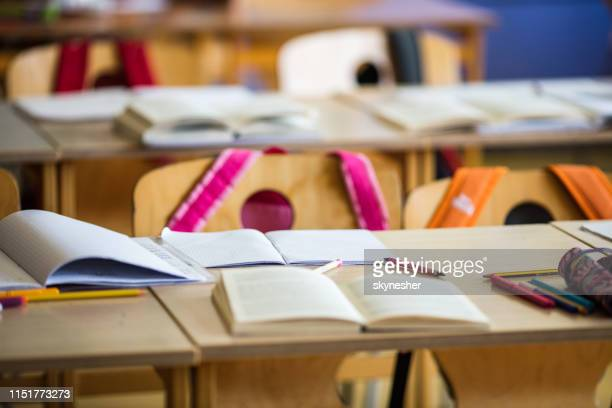 notebooks and books on a desk at elementary school! - elementary school building stock pictures, royalty-free photos & images