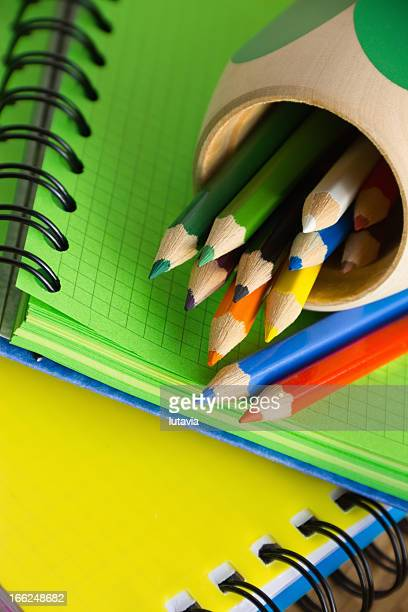 notebooks and pencil-case with colored pencils - lutavia stock pictures, royalty-free photos & images