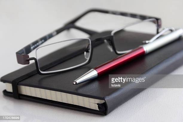 notebooks with pen and glasses - lutavia stock pictures, royalty-free photos & images