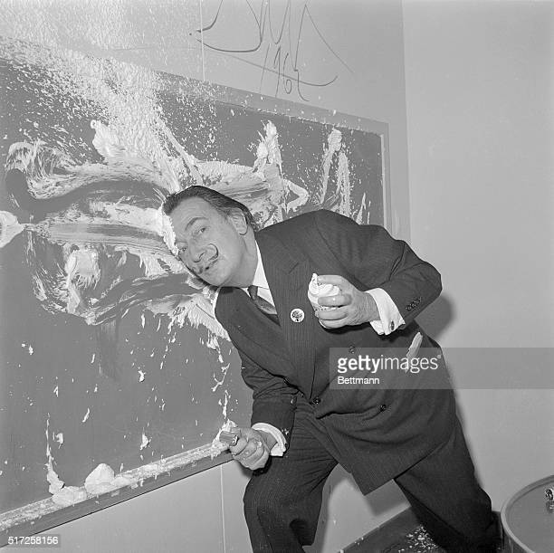 Noted artist Salvador Dali shows a pleasant or at least a new way to clean blackboards April 6th in the children's playroom aboard the SS United...