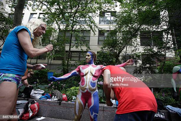 Noted body painting artist Andy Golub staged a body painting festival at Dag Hammarskjold Plaza with dozens of nude near nude models standing by...