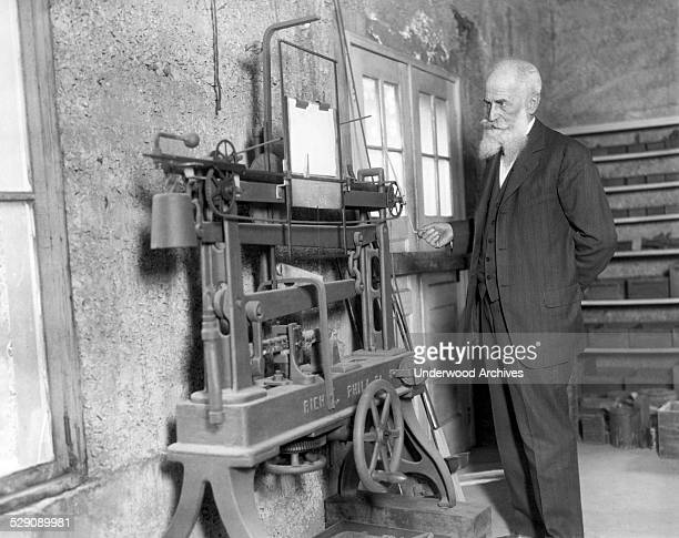 Noted metallurgist and scientist Dr Richard Moldenke at work in his castle laboratory on a device to end all war by destroying the enemy ammunition...
