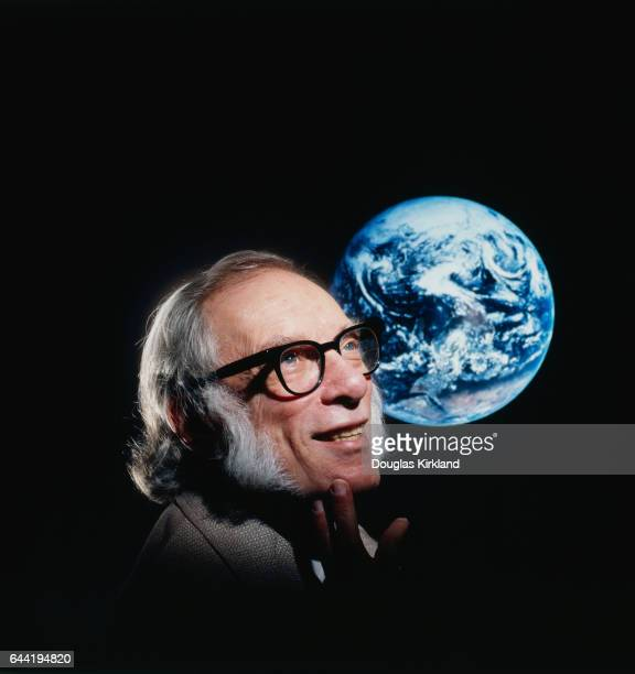 Noted science fiction author Isaac Asimov with a photo of the Earth from space