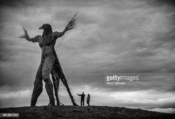 Image has been converted to black and white: The Wickerman built by local craftsmen Trevor Leat will be burned on the final day of the festival at...