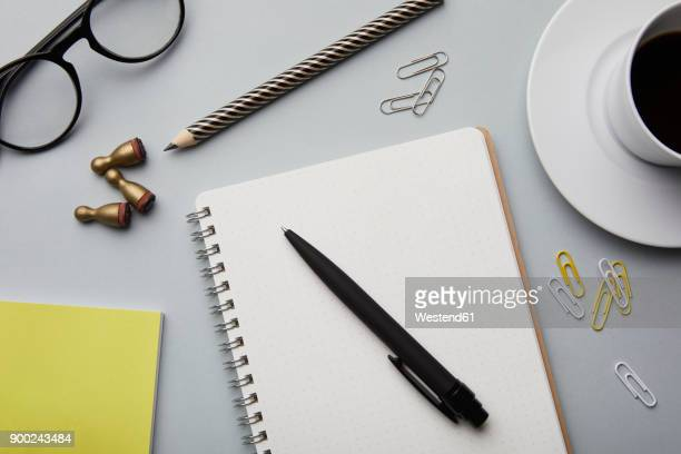 Notepad and office utensils on desk