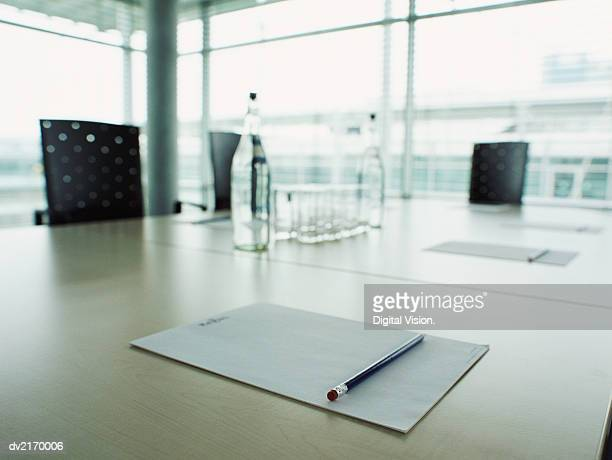 Notepad and Pencil on a Boardroom Table