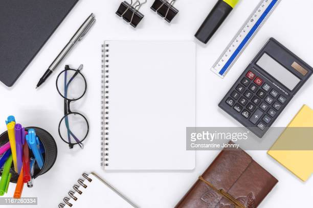 notepad blank page and office supply items on white desk - 文房具 ストックフォトと画像