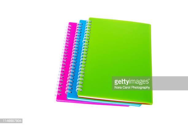 notepad on white background - schulheft stock-fotos und bilder