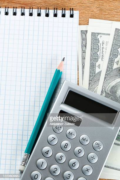 notepad, pencil, money and calculator on the desktop. - dismissal cricket stock pictures, royalty-free photos & images