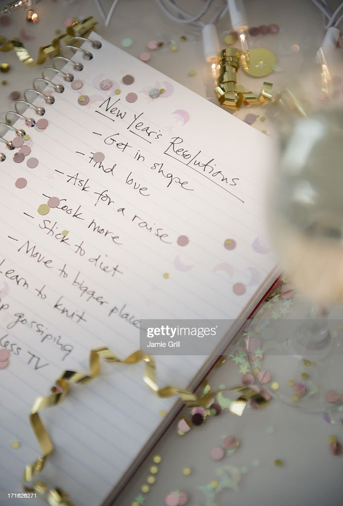 Notepad with New Year's resolutions : Stock Photo