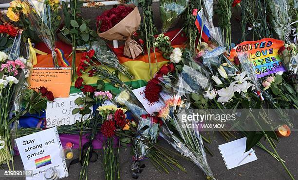 Notes and flowers for the victims of a mass shooting at a gay nightclub in Orlando are seen in front of the US embassy in Moscow on June 13 2016 /...