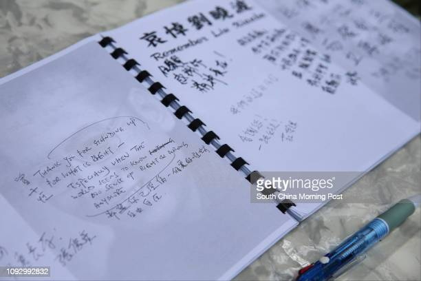 Notes are being written outside the Chinese government's Liaison Office at the Western District in honor of Liu Xiaobo who died of liver cancer on...