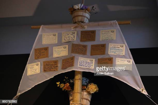 """Notes are displayed on a sail of """"Ghost Ship"""" art installation at the Oakland Museum of California on September 21, 2017 in Oakland, California...."""