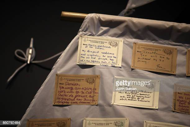 Notes are displayed on a sail of Ghost Ship art installation at the Oakland Museum of California on September 21 2017 in Oakland California Local...