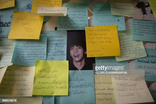 Notes for the late South Korean band SHINee singer Kim JongHyun are seen on a whiteboard during a memorial held by the boyband's Thai fanclub at a...