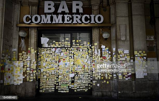 Notes in remmebrance of the 2009 earthquake are sticked on a closed bar on October 22 2012 in L'Aquila Six Italian scientists and a government...
