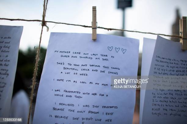 Notes left by visitors are displayed at Washington Square Park, in New York on June 18 2021. - The park has attracted crowds of young people bringing...