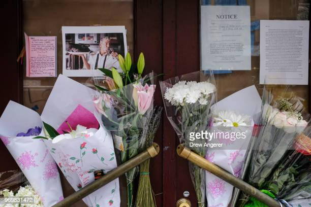 Notes photographs and flowers are left in memory of Anthony Bourdain at the closed location of Brasserie Les Halles where Bourdain used to work as...