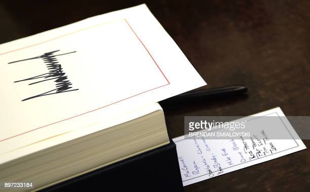Notes seen on the desk of United States President Donald J Trump during an event to sign the Tax Cut and Reform Bill in the Oval Office at The White...