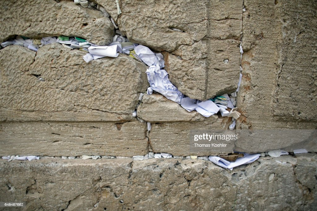 Notes with prayers stuck in the crevices of the Wailing Wall
