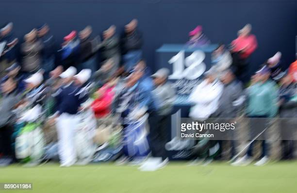 Slow shutter speed camera technique used to create the effect of motion Slow shutterspeed impression shot of a golfer on the 18th tee during the...