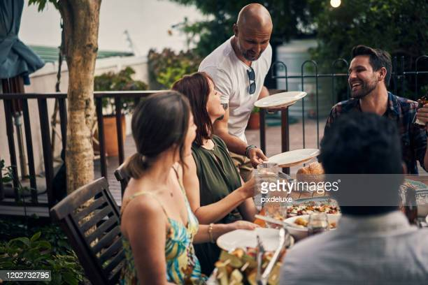 nothing better than a dinner party with friends - party host stock pictures, royalty-free photos & images