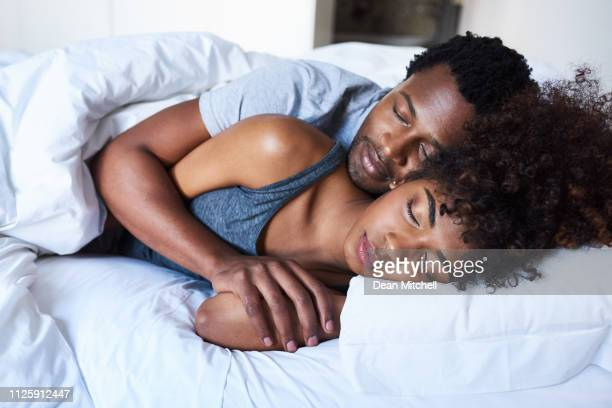 nothing compares to peaceful sleep - couple sleeping stock pictures, royalty-free photos & images