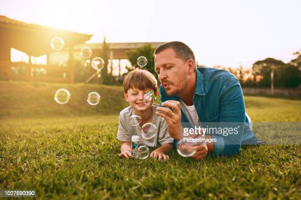 nothing grows a father son bond like fun - son stock pictures, royalty-free photos & images