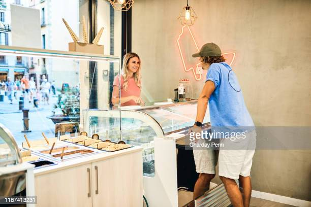 nothing inspires happiness like ice cream - franchising stock pictures, royalty-free photos & images