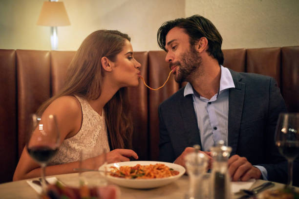 nothing inspires romance quite like italian food - couples romance stock pictures, royalty-free photos & images
