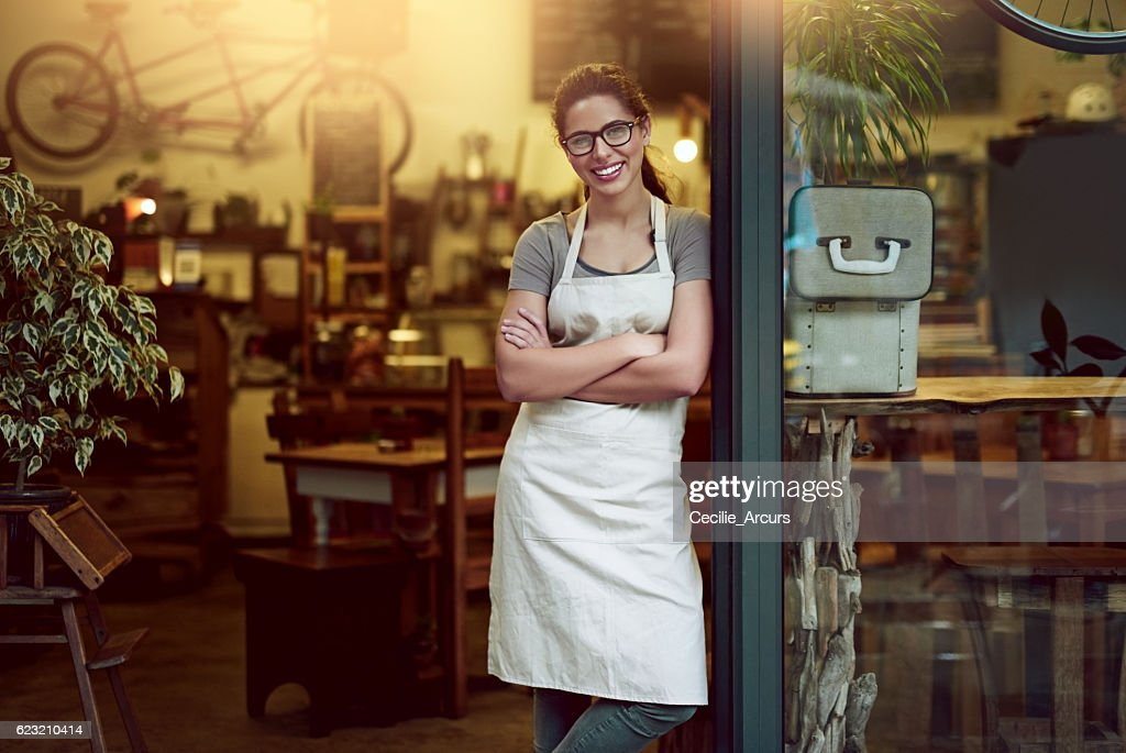 Nothing invites customers to your store like a welcoming smile : Stock Photo