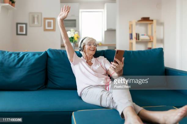 nothing is as relaxing as listening the music - baby boomer stock pictures, royalty-free photos & images