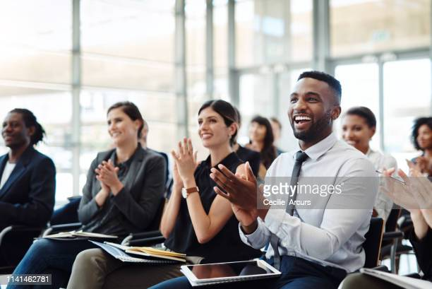 nothing keeps employees inspired like good news - employee stock pictures, royalty-free photos & images