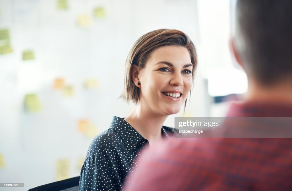 Nothing makes her smile like a productive meeting : Stock Photo