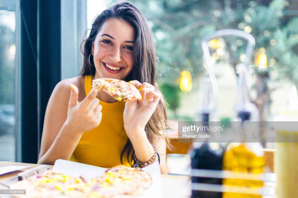 nothing more enjoyable than eating pizza : Stock Photo
