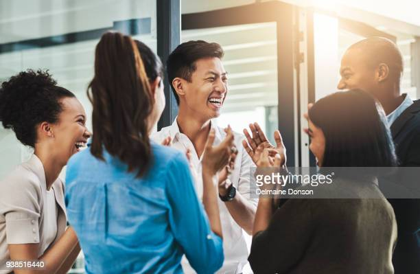 nothing motivates productivity like team morale - happy stock photos and pictures