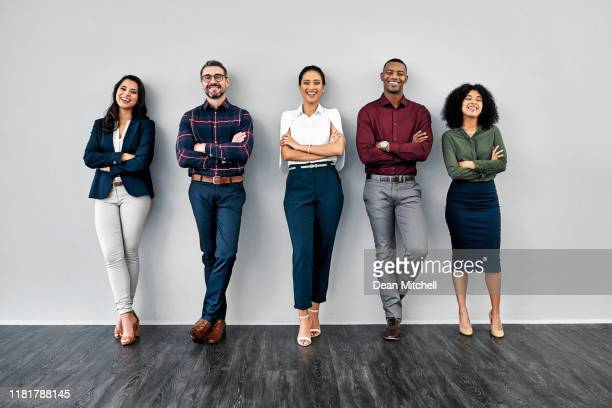 nothing says capability like confidence - group of people stock pictures, royalty-free photos & images