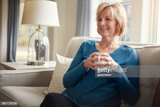 nothing says comfort like a great cup of coffee - one senior woman only stock pictures, royalty-free photos & images