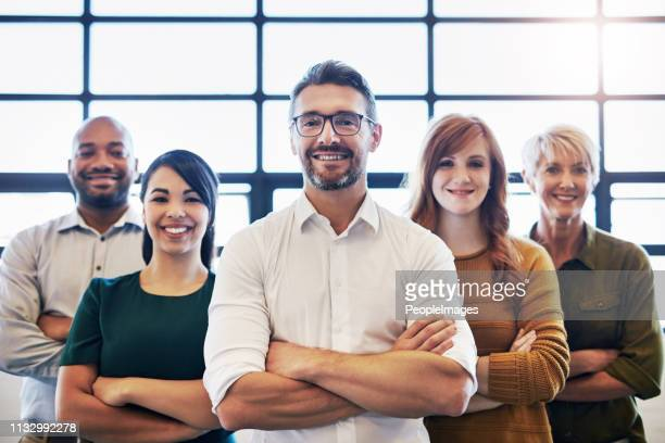 nothing says success like a smiling team - arms crossed stock pictures, royalty-free photos & images