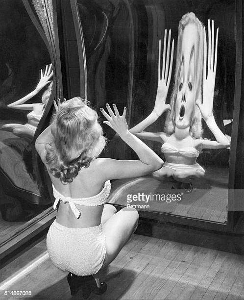 Nothing that Alice ever found behind the lookingglass could be half as weird as the reflection produced by blonde Canda Loden as she tests one of the...