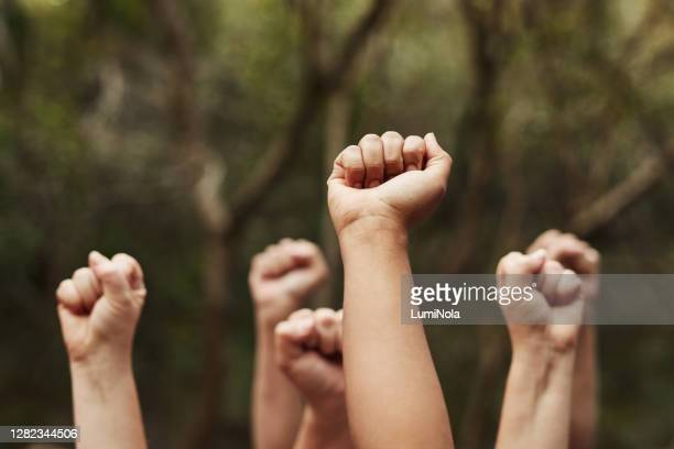 nothing unites us like a common goal - black power movement stock pictures, royalty-free photos & images