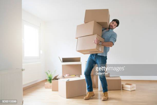nothing's too tough for this guy - unpacking stock pictures, royalty-free photos & images